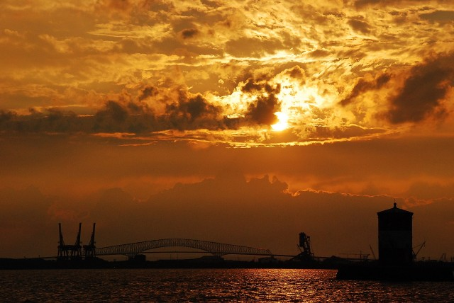 Sunset, 7/28/13, Baltimore, Maryland. From Fort Howard Park.  The Craighill Range Light, with Key Bridge in background. (c) Tim Dicke
