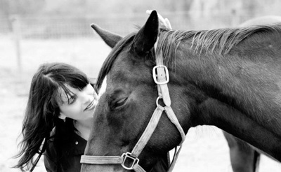 Kelly Young with one of her horses - from www.omegahorserescue.com